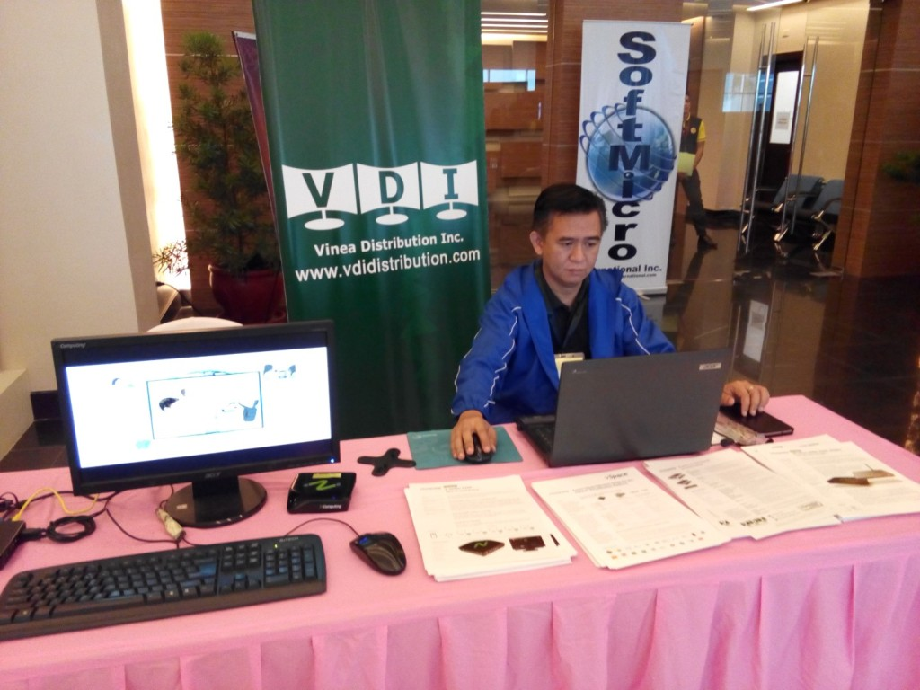 Oliver Joseph Pabilla of VDI inspects the NComputing setup at the VDI booth